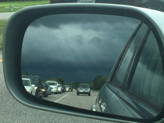 stormy weather in side view mirror