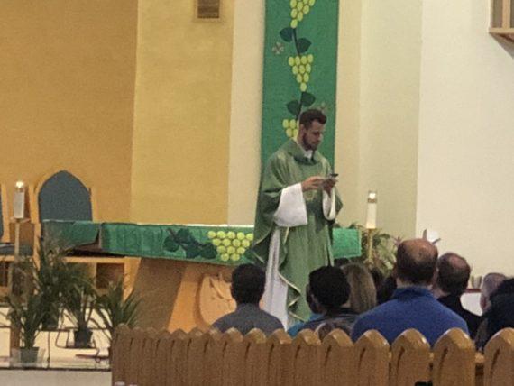 Catholic Priest using technology