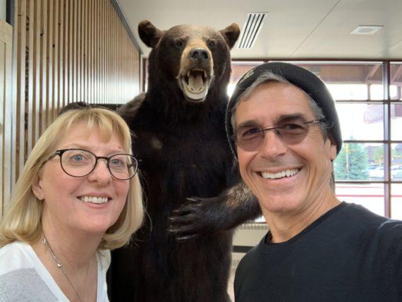 couple next to large stuffed bear