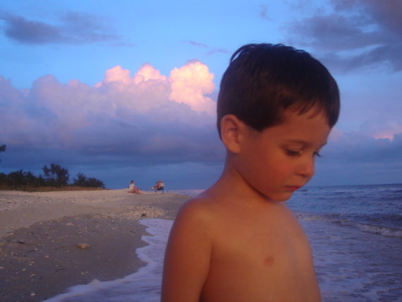 Five year old boy on beach