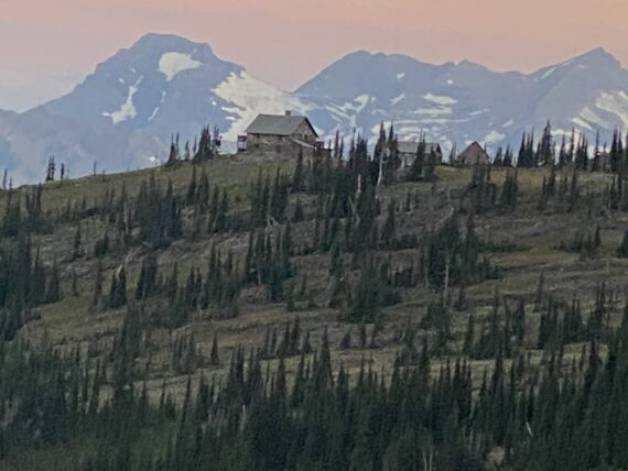Rocky Mountains in Glacier Park at sunrise And mountain chalet
