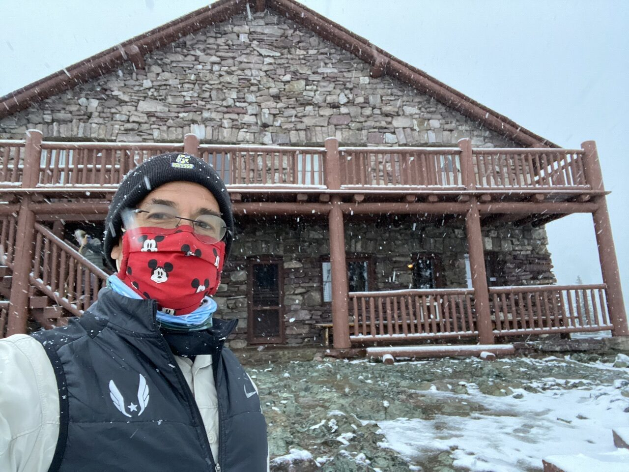 jeff noel in front of Mountain Chalet and snow
