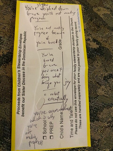 hand-written note on church donation envelope