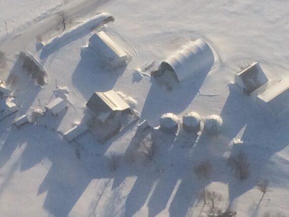 Aerial view of farm covered in snow