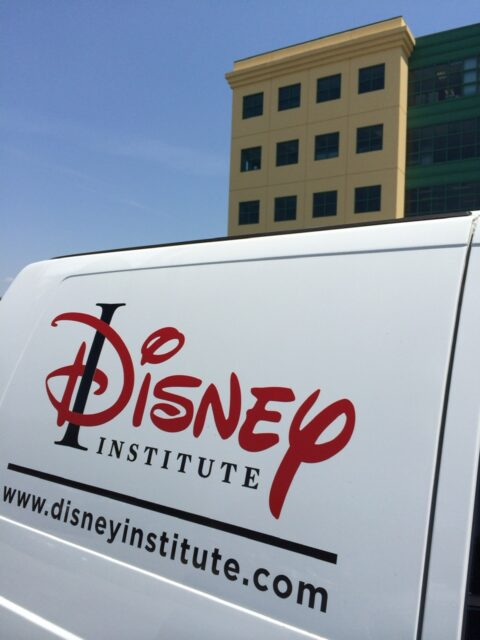 The side of a Disney Institute van