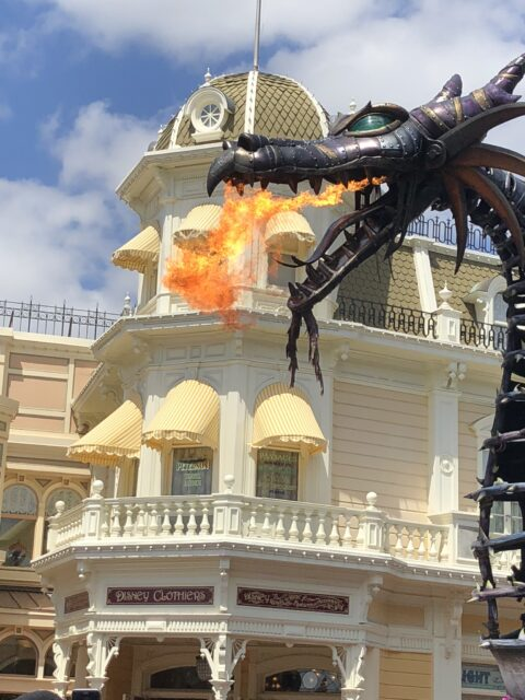 Disney parade float featuring a fire breathing dragon