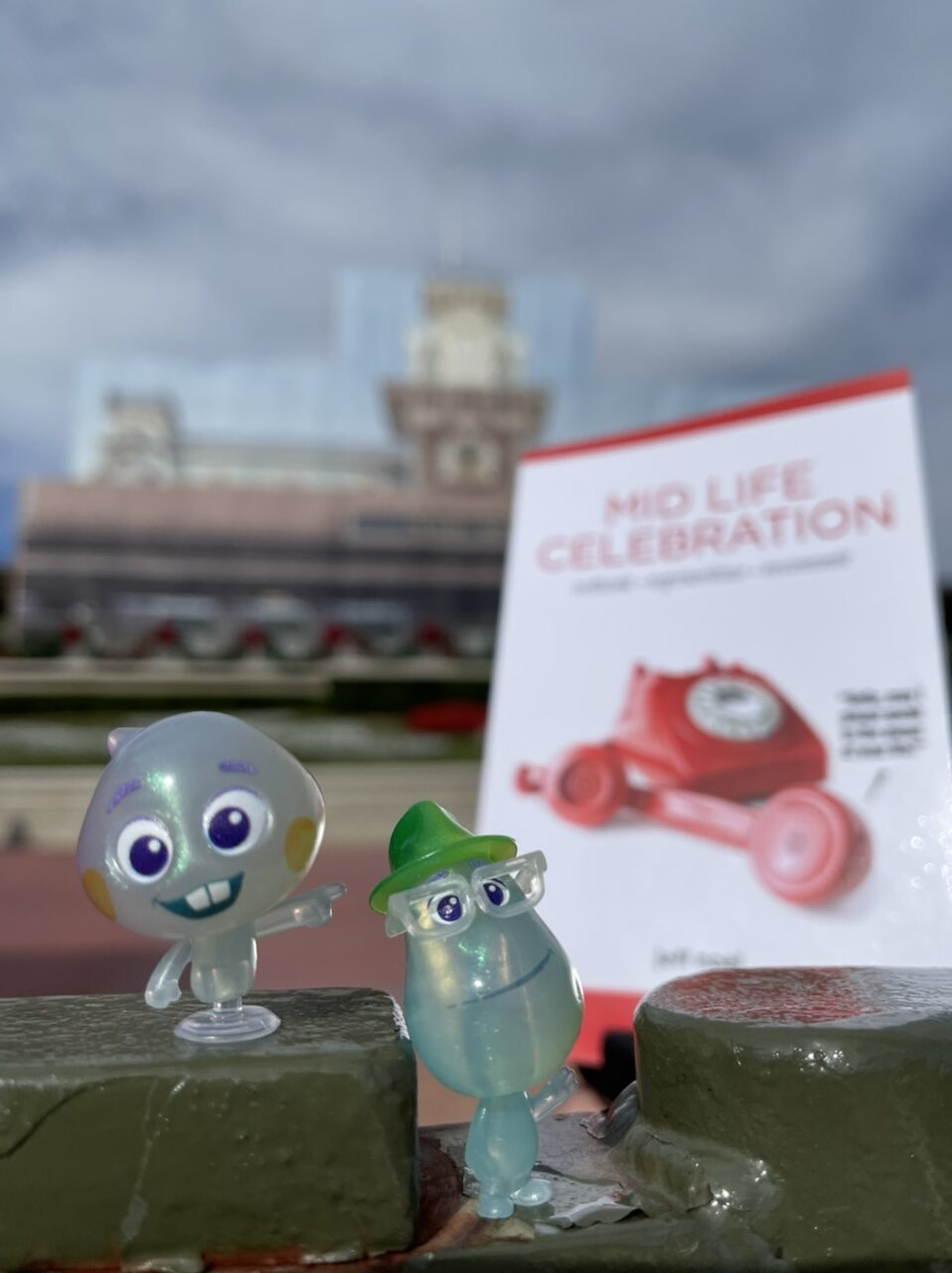 The book Mid Life Celebration with a couple of Pixar soul small toy characters