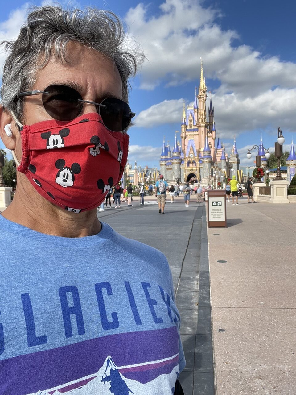 Man in mask with Cinderella Castle in background