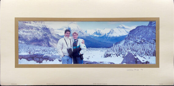 couple posing in snowy mountains