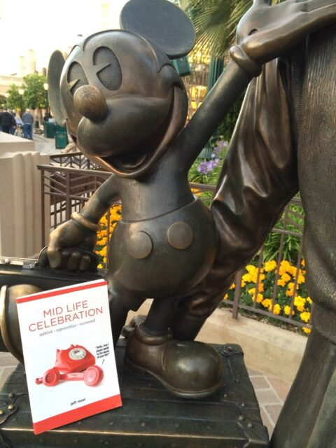 Mickey ouse statue and Mid Life Celebration, the book