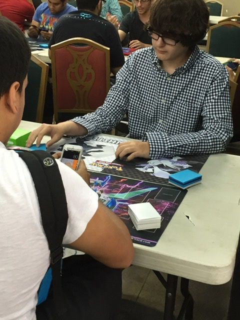 two card players dueling