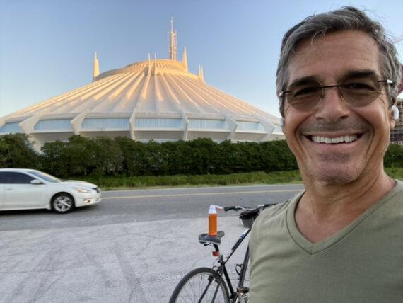 man and bike near Space Mountain