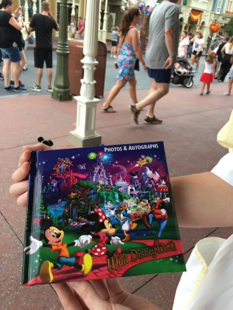 Main Street Confectionary Cast Member asks Guests for their autograph