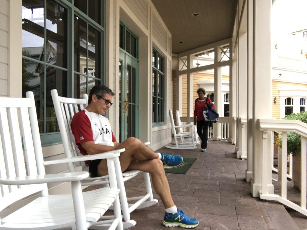 man sitting on rocking chair at Disney