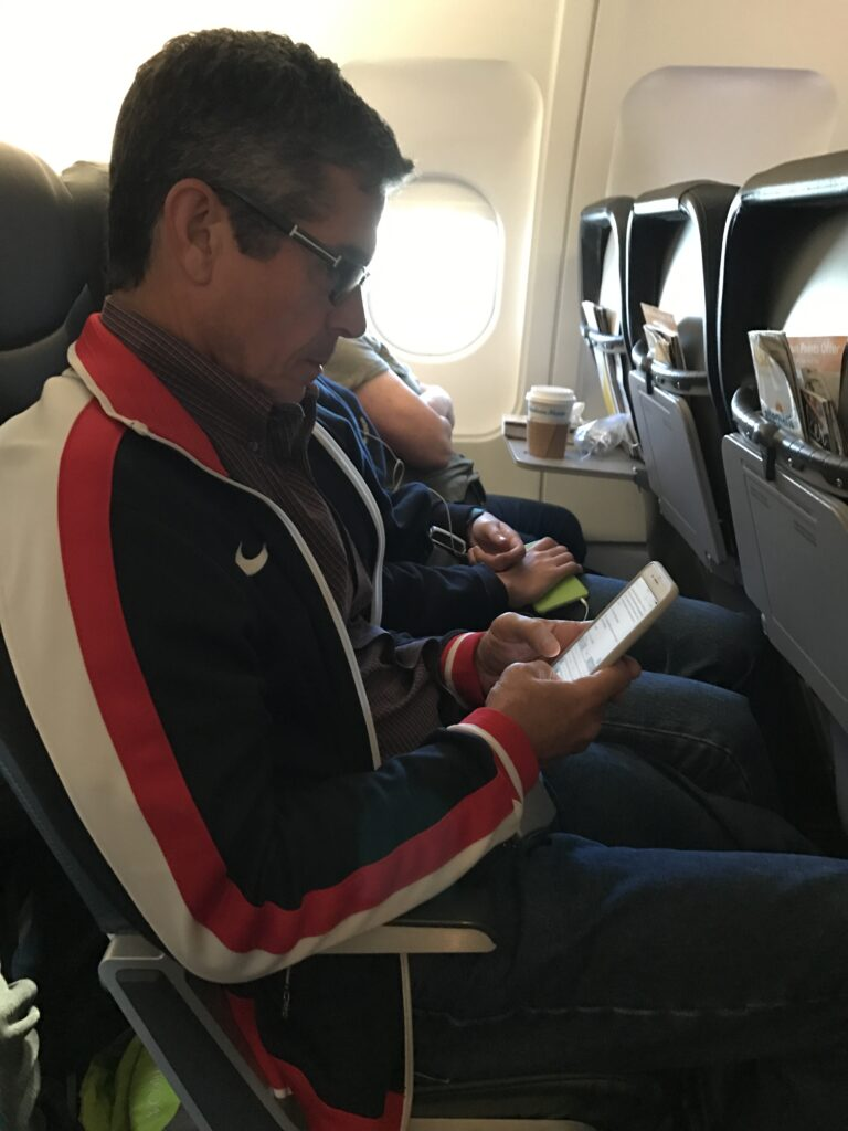 Disney author Jeff Noel writing on a plane
