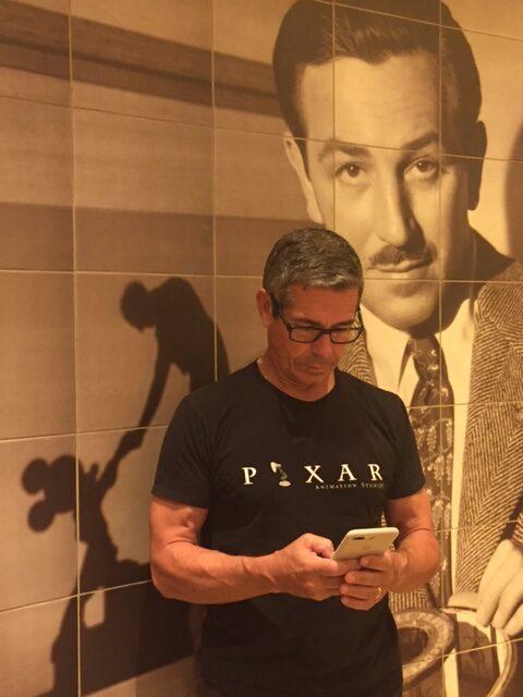 Disney leadership author Jeff Noel writing on iPhone