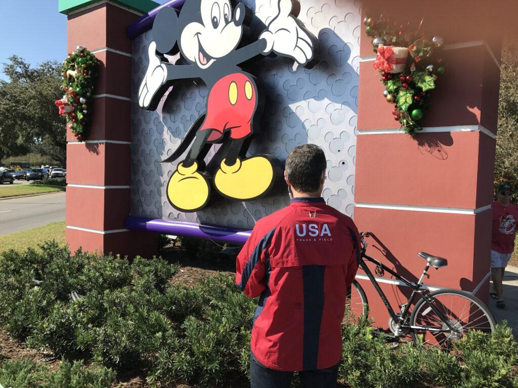 Disney leadership author Jeff Noel writing at Disney Springs entrance