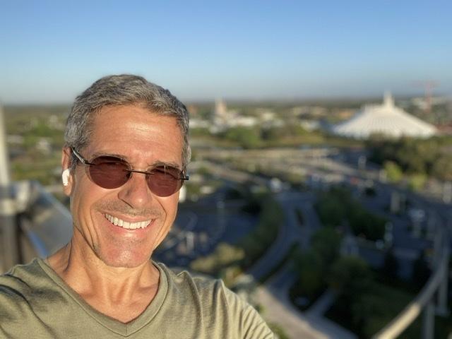 man smiling wearing sun glasses