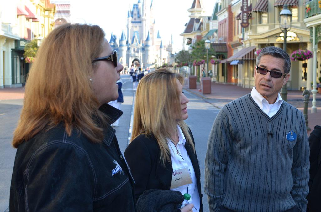 Disney speaker Jeff Noel on Main Street USA with two students