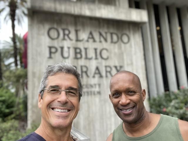 Jeff Noel and Djuan Rivers at Orlando Library sign